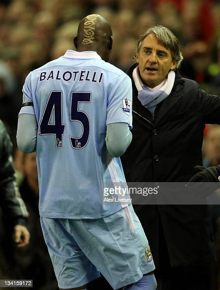 Manchester City Manager Roberto Mancini speaks to Mario Balotelli as he heads for the dressing room after being sent off during the Barclays Premier...