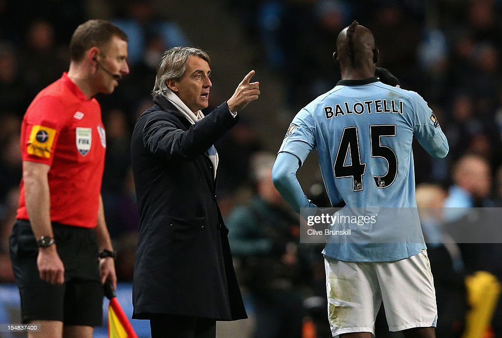 Manchester City Manager <a gi-track='captionPersonalityLinkClicked' href=/galleries/search?phrase=Roberto+Mancini&family=editorial&specificpeople=234429 ng-click='$event.stopPropagation()'>Roberto Mancini</a> speaks to <a gi-track='captionPersonalityLinkClicked' href=/galleries/search?phrase=Mario+Balotelli&family=editorial&specificpeople=4940446 ng-click='$event.stopPropagation()'>Mario Balotelli</a> during the Barclays Premier League match between Manchester City and Swansea City at the Etihad Stadium on October 27, 2012 in Manchester, England.
