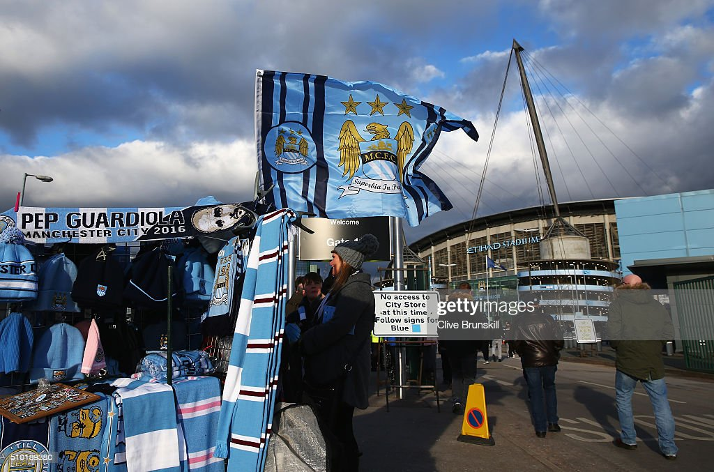 Manchester City merchandise is sold outside the ground prior to the Barclays Premier League match between Manchester City and Tottenham Hotspur at Etihad Stadium on February 14, 2016 in Manchester, England.