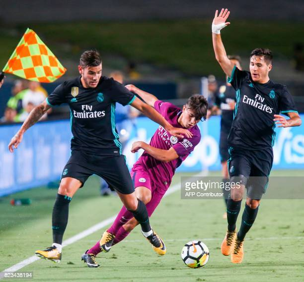 Manchester City midfielder Brahim Diaz center vies the ball against Real Madrid during the second half of the International Champions Cup match on...