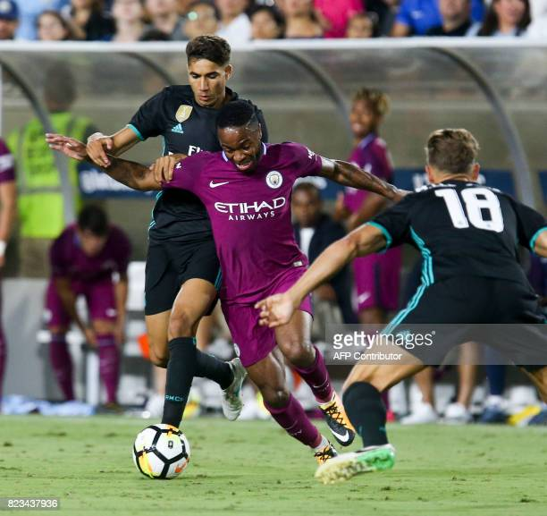 Manchester City midfielder Raheem Sterling center vies the ball against Real Madrid defender Vallejo left and midfielder Marcos Llorente during the...