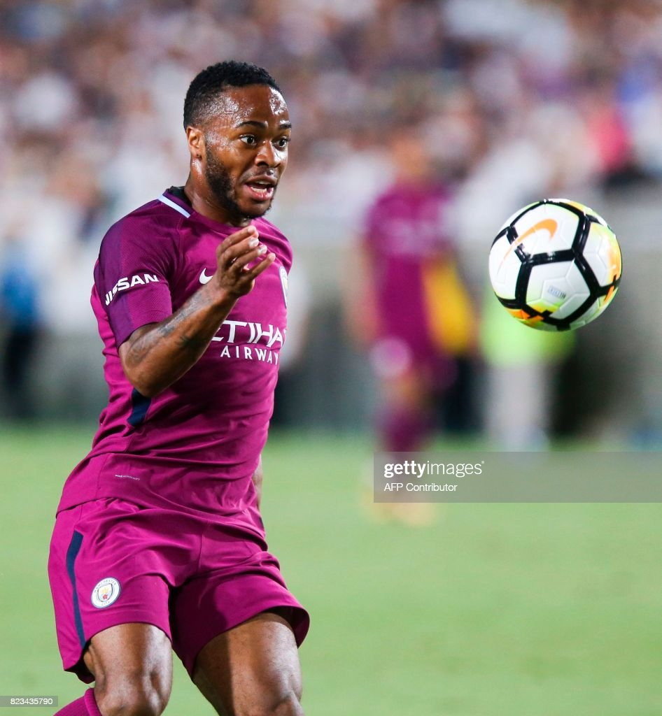 Manchester City midfielder Raheem Sterling drives the ball against