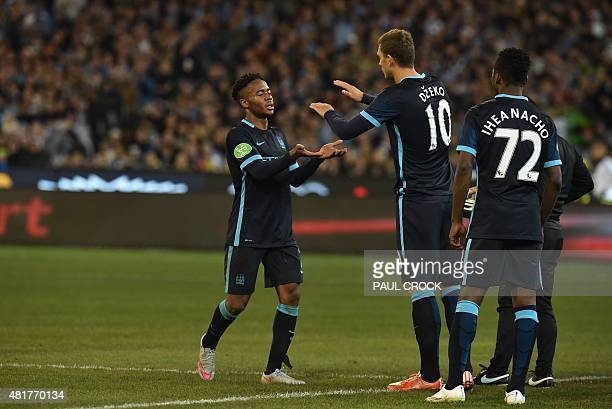 Manchester City midfielder Raheem Sterling subs off with Edin Dzeko during the International Champions Cup Australia football match between English...
