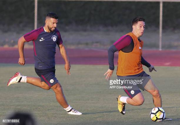 Manchester City midfielder Samir Nasri and teammate Sergio Aguero participate in a training session at the StubHub Center on July 25 2017 in Carson...