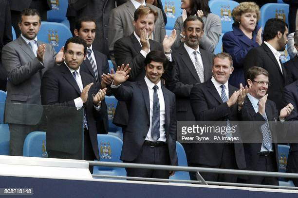 Manchester City owner Sheikh Mansour bin Zayed bin Sultan Al Nahyan waves from the stands prior to kickoff