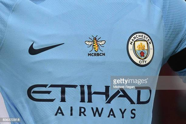Manchester City pay tribute to terror attack victims with bumblebee during the Premier League match between Manchester City and Everton at Etihad...