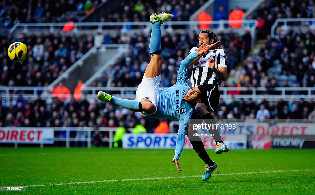 Manchester City player <a gi-track='captionPersonalityLinkClicked' href=/galleries/search?phrase=Carlos+Tevez&family=editorial&specificpeople=220555 ng-click='$event.stopPropagation()'>Carlos Tevez</a> attempts an overhead kick watched by <a gi-track='captionPersonalityLinkClicked' href=/galleries/search?phrase=Jonas+Gutierrez&family=editorial&specificpeople=771739 ng-click='$event.stopPropagation()'>Jonas Gutierrez</a> during the Barclays Premier League match between Newcastle United and Manchester City at St James' Park on December 15, 2012 in Newcastle upon Tyne, England.
