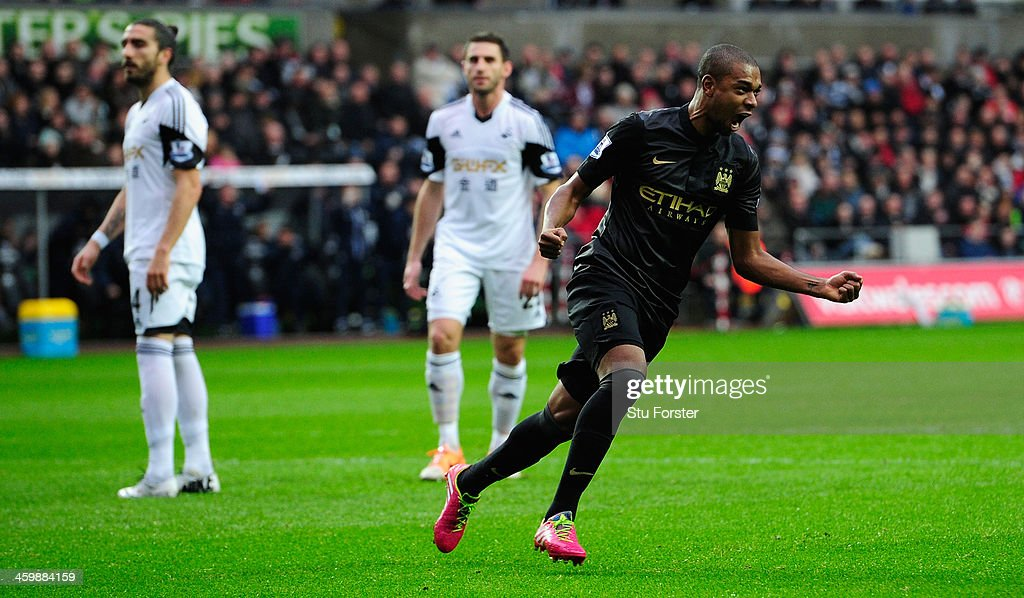 Manchester City player <a gi-track='captionPersonalityLinkClicked' href=/galleries/search?phrase=Fernandinho+-+Soccer+Player+-+Manchester+City&family=editorial&specificpeople=10093285 ng-click='$event.stopPropagation()'>Fernandinho</a> (r) celebrates the opening goal during the Barclays Premier League match between Swansea City and Manchester City at Liberty Stadium on January 1, 2014 in Swansea, Wales.