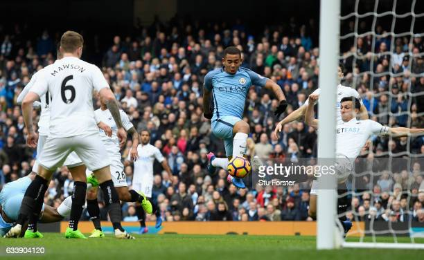 Manchester City player Gabriel Jesus scores the opening goal during the Premier League match between Manchester City and Swansea City at Etihad...