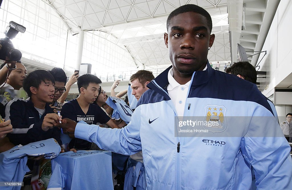 Manchester City player <a gi-track='captionPersonalityLinkClicked' href=/galleries/search?phrase=Micah+Richards+-+Soccer+Player&family=editorial&specificpeople=647038 ng-click='$event.stopPropagation()'>Micah Richards</a> is greeted by fans at Hong Kong Airport as the team arrives to compete in the Barclays Asia Trophy, on July 22, 2013 in Hong Kong.