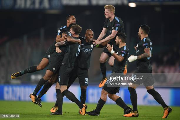 Manchester City players celebrate after Manchester City's English defender John Stones' goal during the UEFA Champions League football match Napoli...