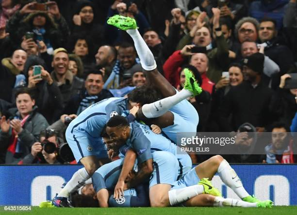 TOPSHOT Manchester City players celebrate after Manchester City's German midfielder Leroy Sane scored their fifth goal during the UEFA Champions...