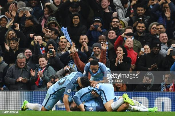 Manchester City players celebrate after Manchester City's German midfielder Leroy Sane scored their fifth goal during the UEFA Champions League Round...