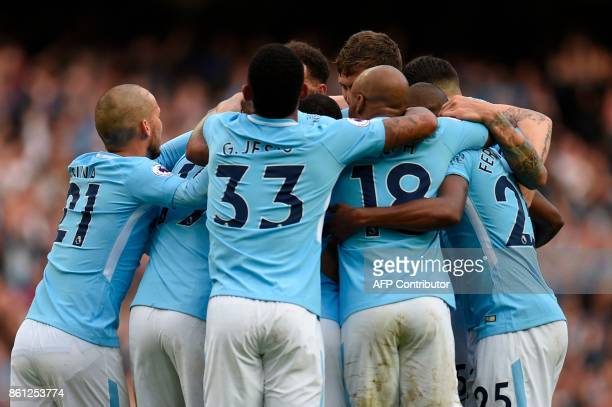 Manchester City players celebrate after Manchester City's German midfielder Leroy Sane scored their sixth goal during the English Premier League...