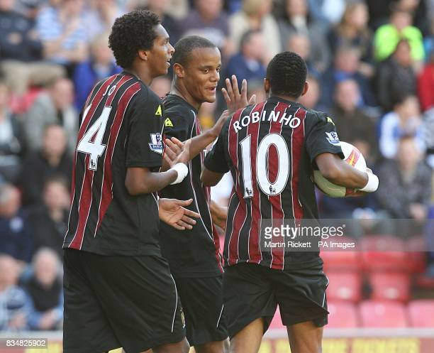 Manchester City players celebrate after Vincent Kompany scores the second goal of the match