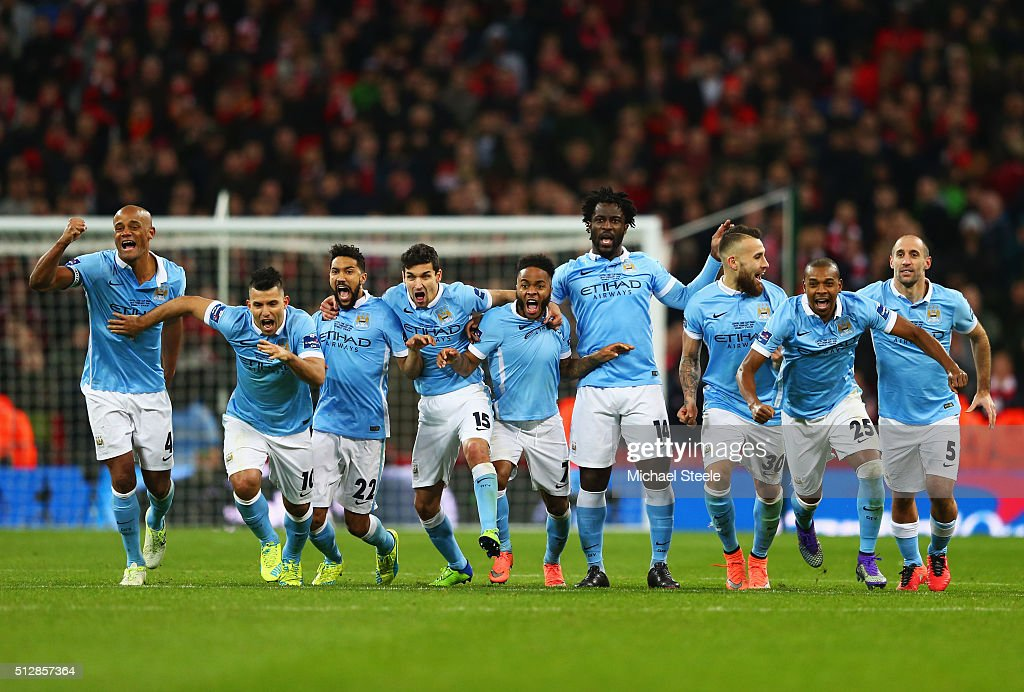Manchester City players celebrate as Yaya Toure of scores the winning penalty to win the shoot out during the Capital One Cup Final match between...