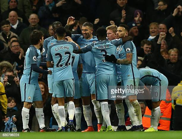 Manchester City players celebrate the goal scored by Sergio Aguero during the Premier League match between Manchester City and Burnley at Etihad...