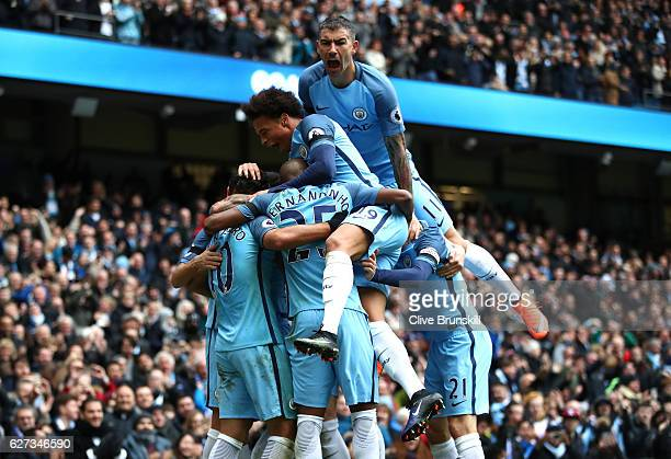 Manchester City players celebrate their team's first goal during the Premier League match between Manchester City and Chelsea at Etihad Stadium on...