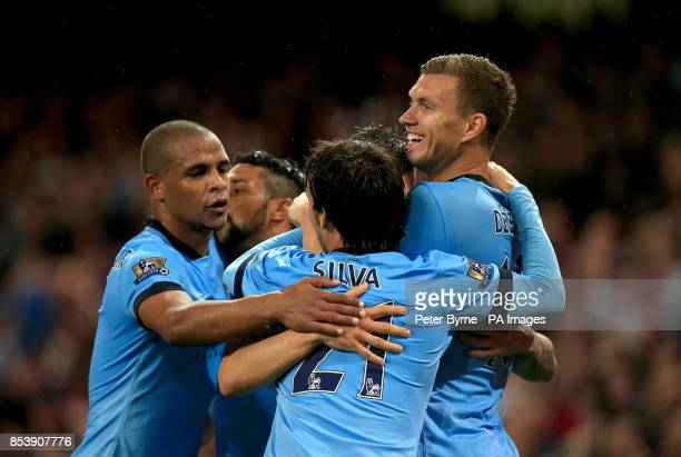 Manchester City players celebrate their teams opening goal scored by Stevan Jovetic during the Barclays Premier League match at the Etihad Stadium...