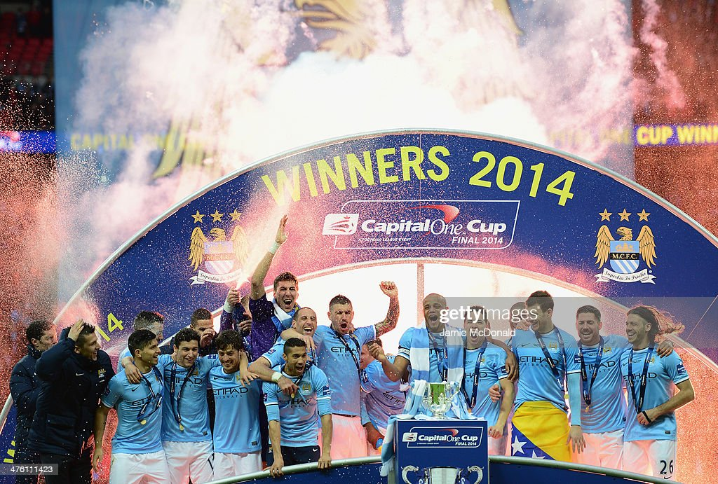 Manchester City players celebrate victory after the Capital One Cup Final between Manchester City and Sunderland at Wembley Stadium on March 2, 2014 in London, England.