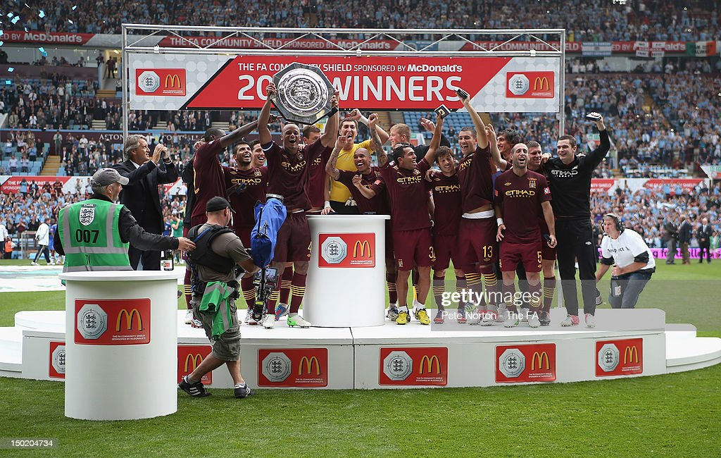 Manchester City players celebrate victory in the FA Community Shield match between Manchester City and Chelsea at Villa Park on August 12, 2012 in Birmingham, England.