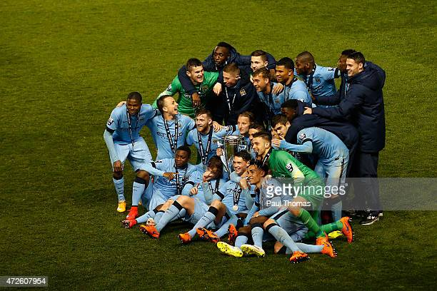 Manchester City players celebrate with the trophy after the Premier League International Cup Final match between Manchester City and FC Porto at the...