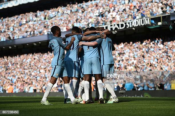 Manchester City players celebrates the opening goal scored by their Belgian midfielder Kevin De Bruyne from a free kick during the English Premier...