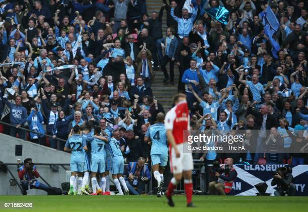Manchester City players celerbate their first goal scored by Sergio Aguero during the Emirates FA Cup SemiFinal match between Arsenal and Manchester...
