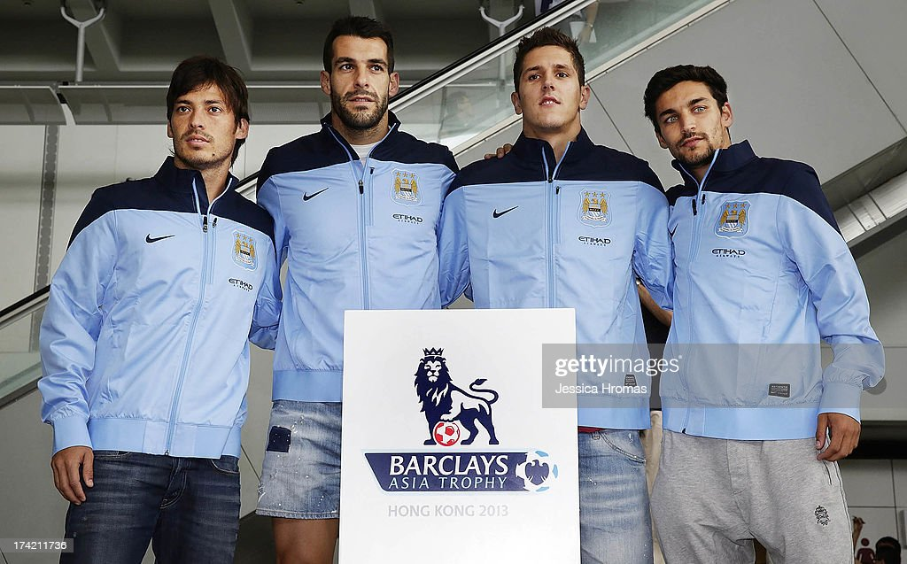 Manchester City players <a gi-track='captionPersonalityLinkClicked' href=/galleries/search?phrase=David+Silva&family=editorial&specificpeople=675795 ng-click='$event.stopPropagation()'>David Silva</a>, <a gi-track='captionPersonalityLinkClicked' href=/galleries/search?phrase=Alvaro+Negredo&family=editorial&specificpeople=4085785 ng-click='$event.stopPropagation()'>Alvaro Negredo</a>, Stevan Jovetic and Jesus Navas pose for a photo at Hong Kong Airport as they arrive to compete in the Barclays Asia Trophy, on July 22, 2013 in Hong Kong. <a gi-track='captionPersonalityLinkClicked' href=/galleries/search?phrase=Alvaro+Negredo&family=editorial&specificpeople=4085785 ng-click='$event.stopPropagation()'>Alvaro Negredo</a>, Stevan Jovetic and Jesus Navas have been newly signed to the club.