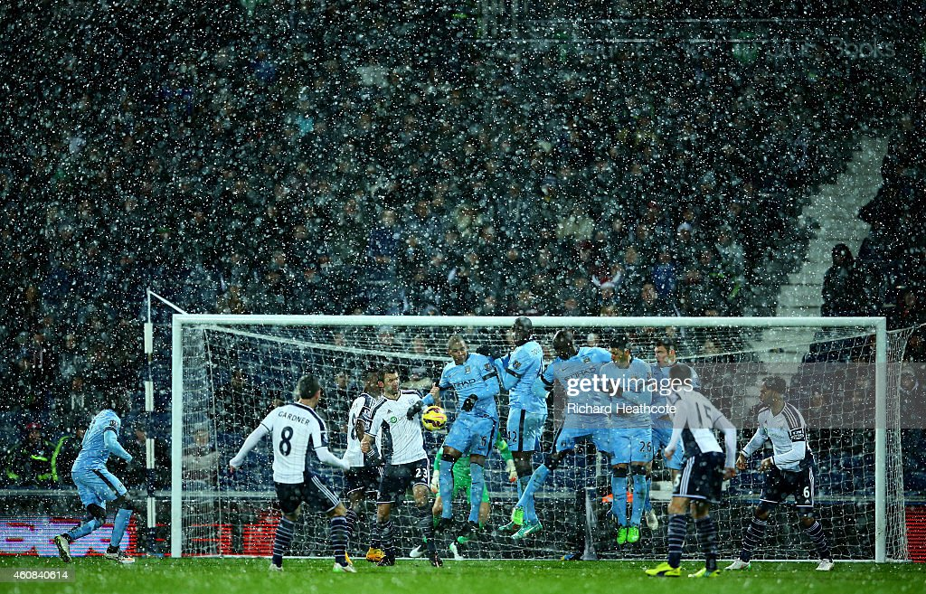 Manchester City players defend a free-kick taken by Craig Gardner of West Brom during the Barclays Premier League match between West Bromwich Albion and Manchester City at The Hawthorns on December 26, 2014 in West Bromwich, England.