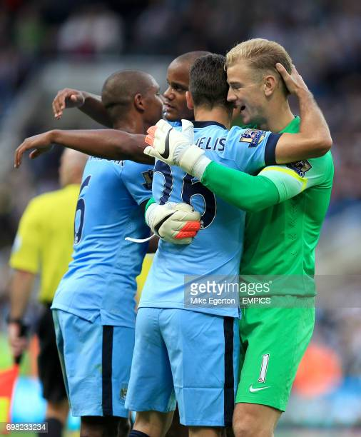 Manchester City players Fernando Vincent Kompany Martin Demichelis and Joe Hart celebrate after the game