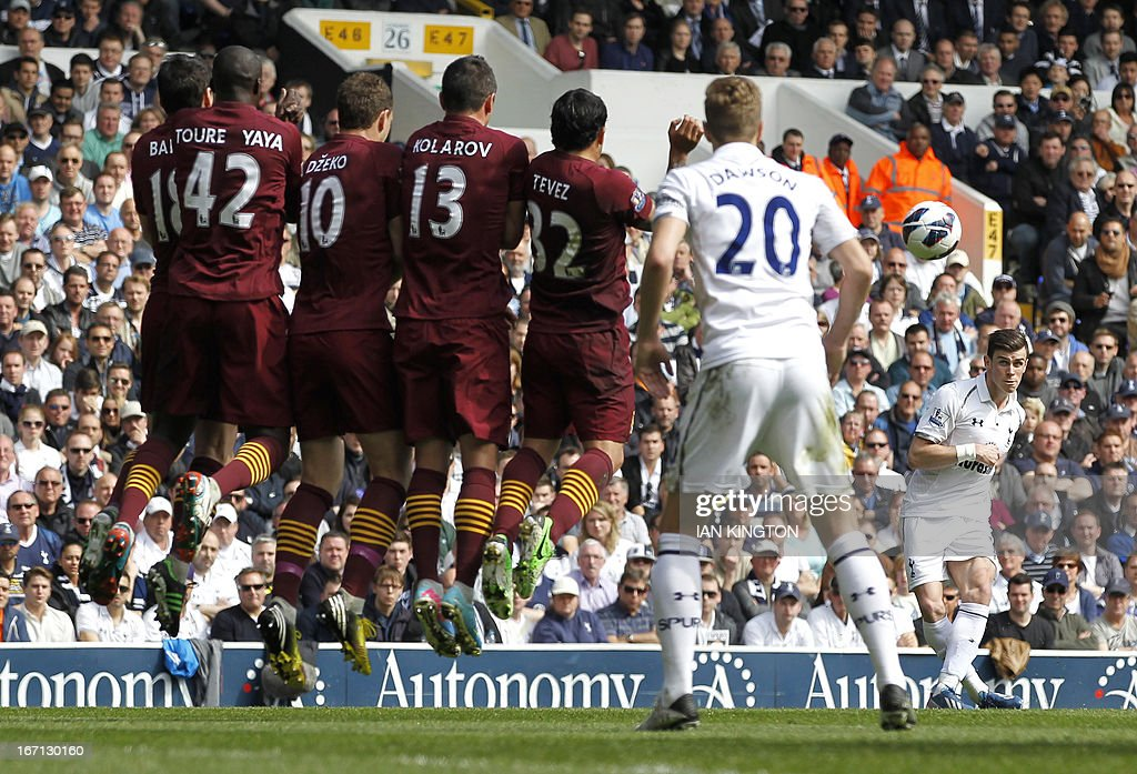 "Manchester City players jump in the wall as Tottenham Hotspur's Welsh midfielder Gareth Bale (R) takes a freekick during the English Premier League football match between Tottenham Hotspur and Manchester City at White Hart Lane in north London on April 21, 2013. Tottenham won the game 3-1. USE. No use with unauthorized audio, video, data, fixture lists, club/league logos or ""live"" services. Online in-match use limited to 45 images, no video emulation. No use in betting, games or single club/league/player publications"