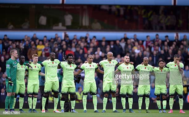 Manchester City players observe a minutes silence ahead of the English Premier League football match between Aston Villa and Manchester City at Villa...