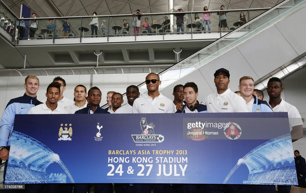 Manchester City players pose for a team photo at Hong Kong Airport as they arrive to compete in the Barclays Asia Trophy, on July 22, 2013 in Hong Kong.
