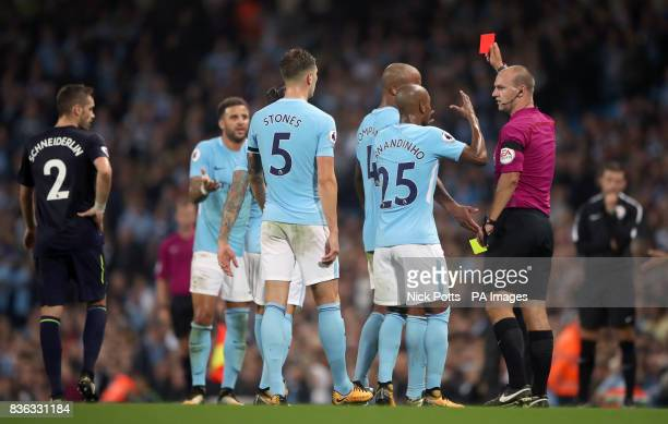 Manchester City players protest as referee Robert Madley shows Kyle Walker a red card during the Premier League match at the Etihad Stadium Manchester