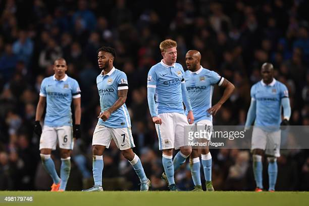 Manchester City players show their dejecton after conceding the fourth goal to Liverpool during the Barclays Premier League match between Manchester...