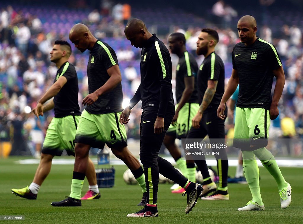 Manchester City players warm up before the Champions League semi-final second leg football match between Real Madrid CF and Manchester City at the Santiago Bernabeu stadium in Madrid on May 4, 2016. / AFP / GERARD