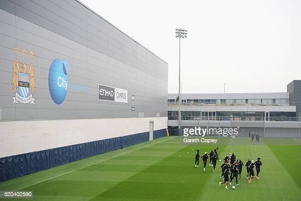 Manchester City players warm up during a training session ahead of the UEFA Champions League Quarter Final Second Leg match against Paris...
