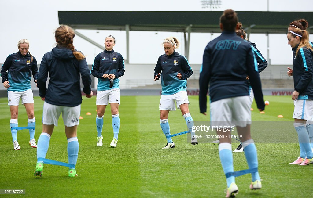 Manchester City players warm up during the game between Manchester City Women and Doncaster Belles at the Manchester City Academy Stadium on May 2, 2016 in Manchester, England.