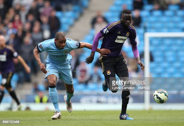Manchester City 's Fernando Reges and West Ham United's Cheikhou Kouyate