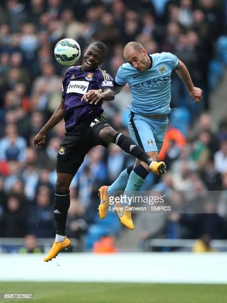 Manchester City 's Pablo Zabaleta and West Ham United's Enner Valenica