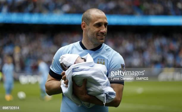 Manchester City 's Pablo Zabaleta with his newborn child before the match