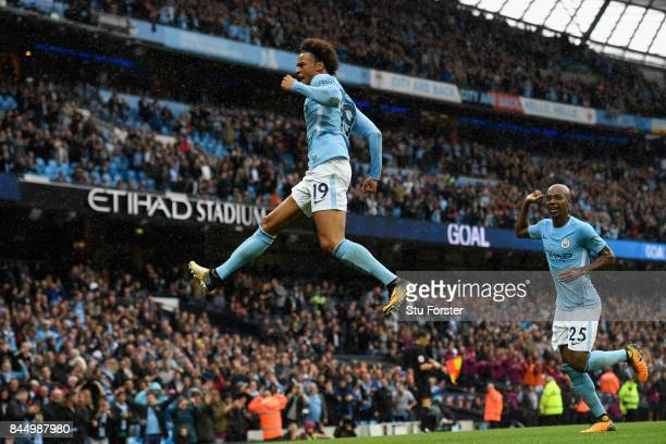 Manchester City striker Leroy Sane celebrates after scoiring the fifth Manchester City goal during the Premier League match between Manchester City...