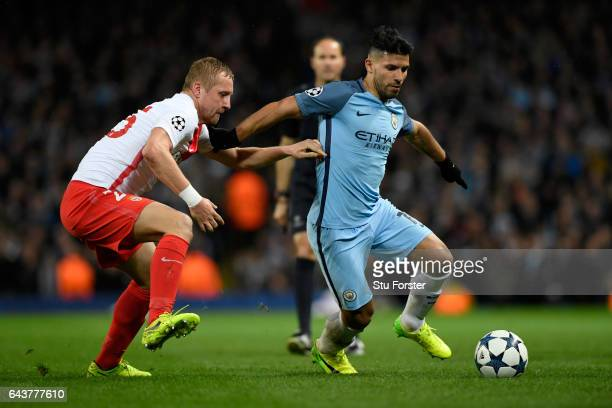 Manchester City striker Sergio Aguero holds off the challenge of Kamil Glik during the UEFA Champions League Round of 16 first leg match between...