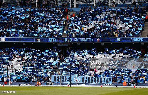 Manchester City supporters cheer during the Barclays Premier League match between Manchester City and Southampton at Etihad Stadium on May 24 2015 in...
