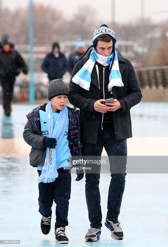 Manchester City supporters make their way to the stadium prior to the Barclays Premier League match between Manchester City and Leicester City at the Etihad Stadium on February 6, 2016 in Manchester, England.