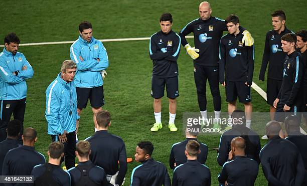 Manchester City team manager Manuel Pellegrini addresses the squad ahead of a team training session during the International Champions Cup football...