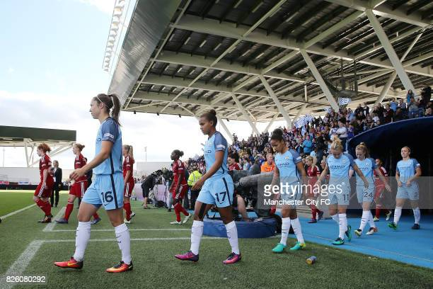 Manchester City Women and Birmingham City Ladies walk out at the City Academy Stadium