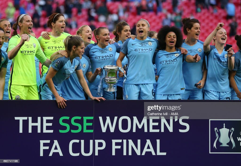 Manchester City Women celebrate with the trophy during the SSE Women's FA Cup Final between Birmingham City Ladies and Manchester City Women at Wembley Stadium on May 13, 2017 in London, England.