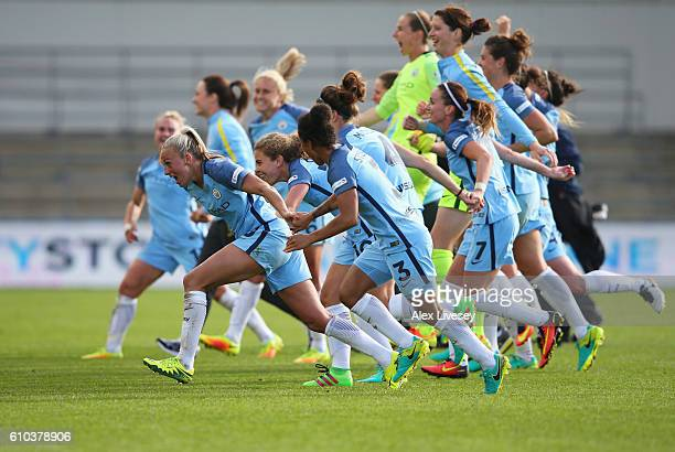 Manchester City Women players celebrate as they win the WSL title after the WSL 1 match between Manchester City Women and Chelsea Ladies FC at...